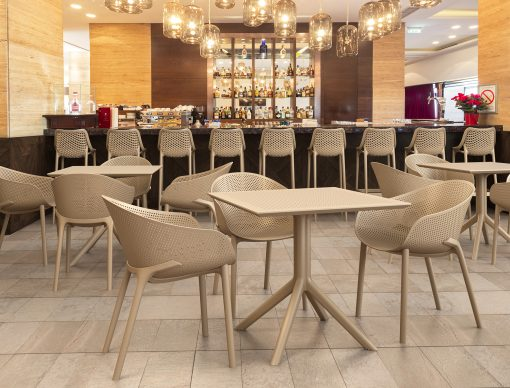 Sky Table 80 and Sky Chair Setting with Air Barstools in a Restaurant